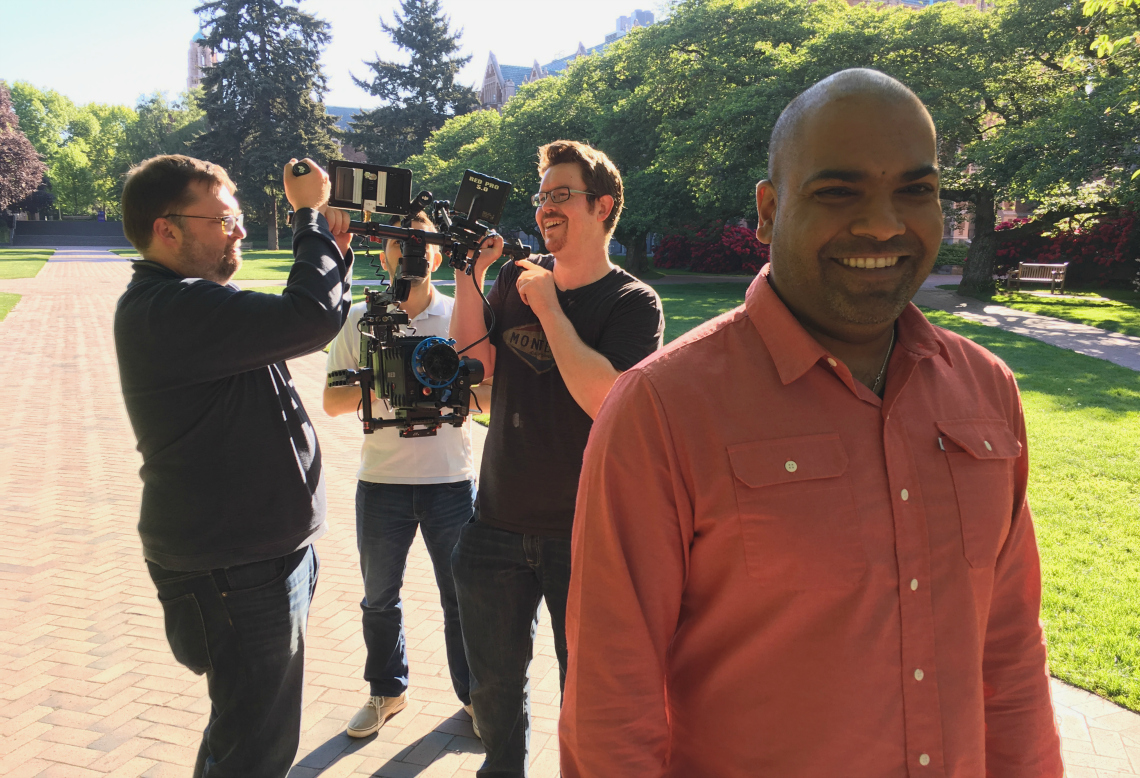 Comm Lead Director Hanson Hosein grins as students (from left) Scott Morris, Sebastian Sanchez and Scott Wilson handle the camera rig during Four Peaks filming.