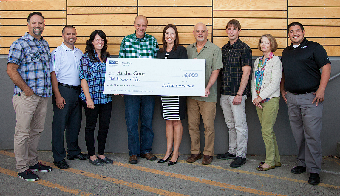 A Safeco agent presents a larger-than-life check to the 'At the Core' nonprofit. Holzer's work on this PR campaign has helped generate over 2.5 million impressions nationwide in the last four months.
